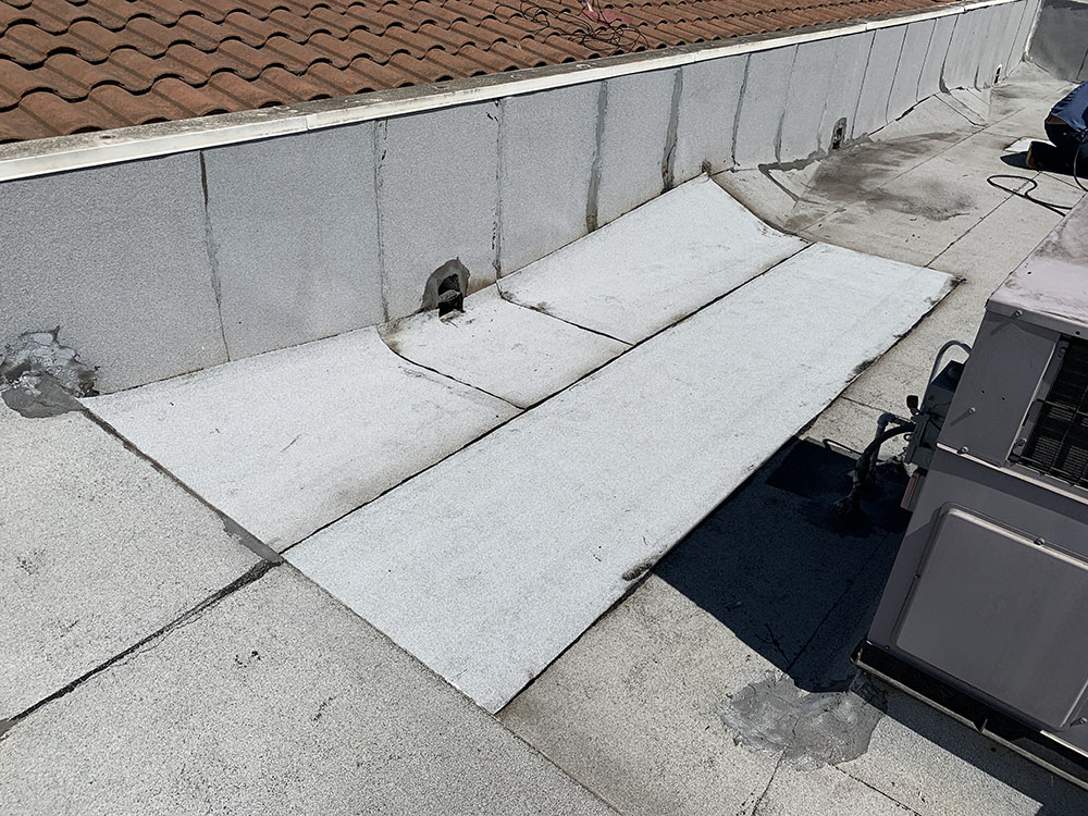 before photo of a commercial roof repair project in southern ca