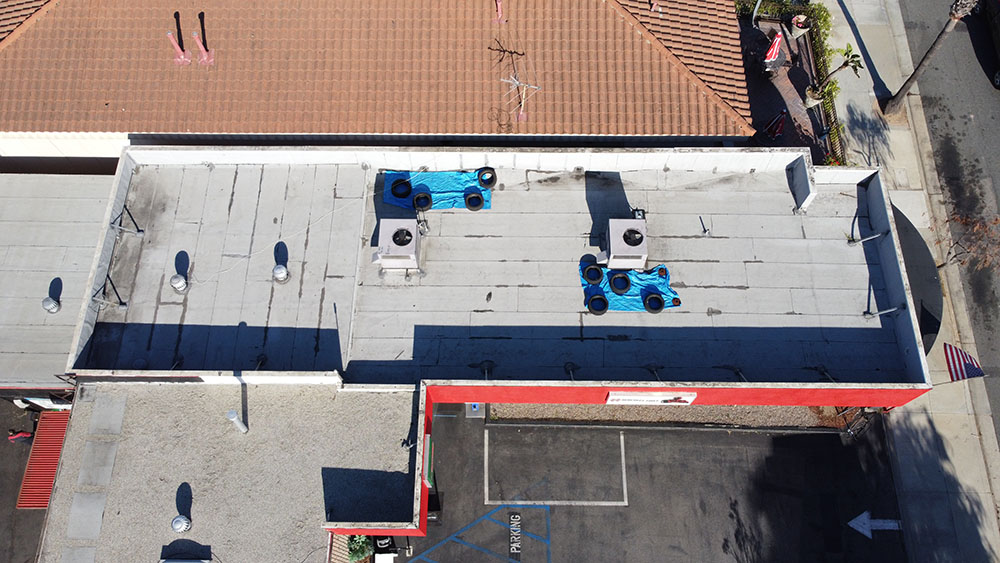 drone overhead photo of an auto body shop roofing project