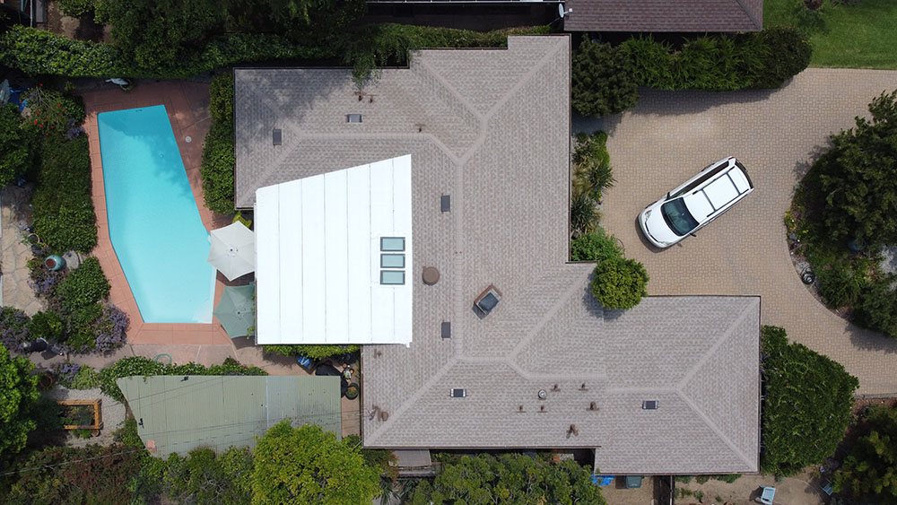 drone picture in altadena of a residential roofing project with shingles